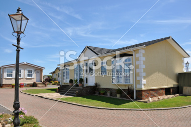 stock-photo-9894470-residential-mobile-home-on-a-quality-caravan-park-estate